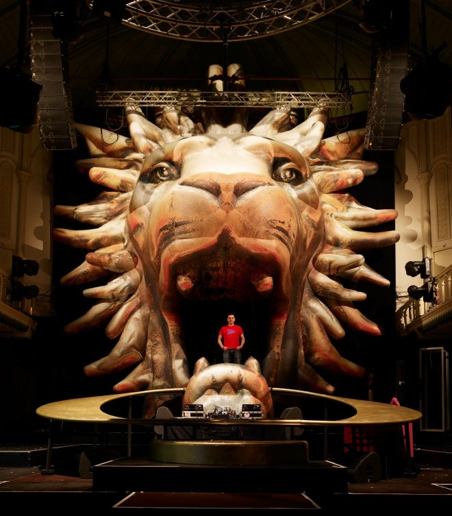 Giant inflatable Lion Head and jaw on stage at Paradiso Amsterdam