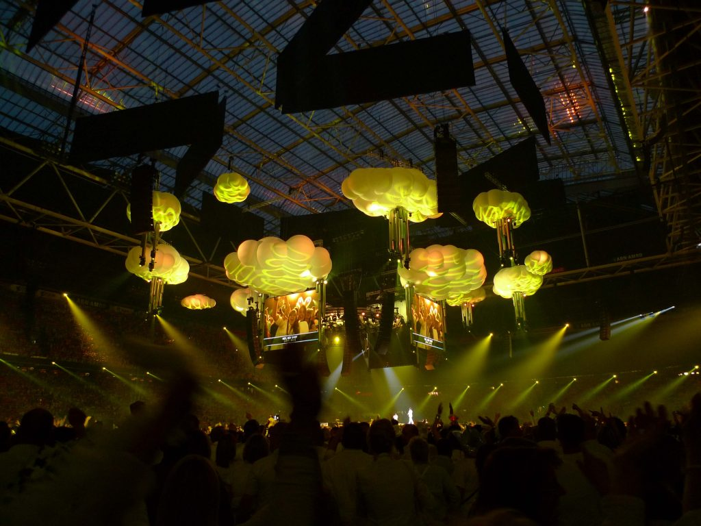 Inflatable clouds for Toppers 2010 in a stadium with large crowd below