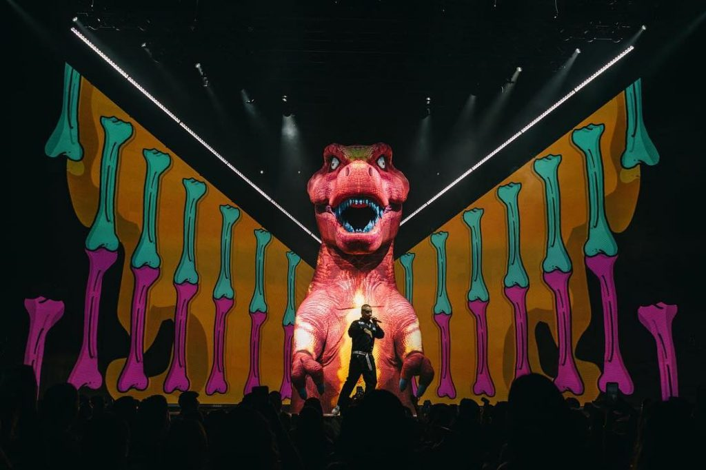 Giant inflatable T-Rex on stage with J Balvin